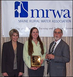 Presenting the Award - Left to Right: Kirsten Hebert, MRWA Deputy Executive Director - Margaret Muller, Office Manager Winterport Water District - Steve Levy, MRWA Executive Director